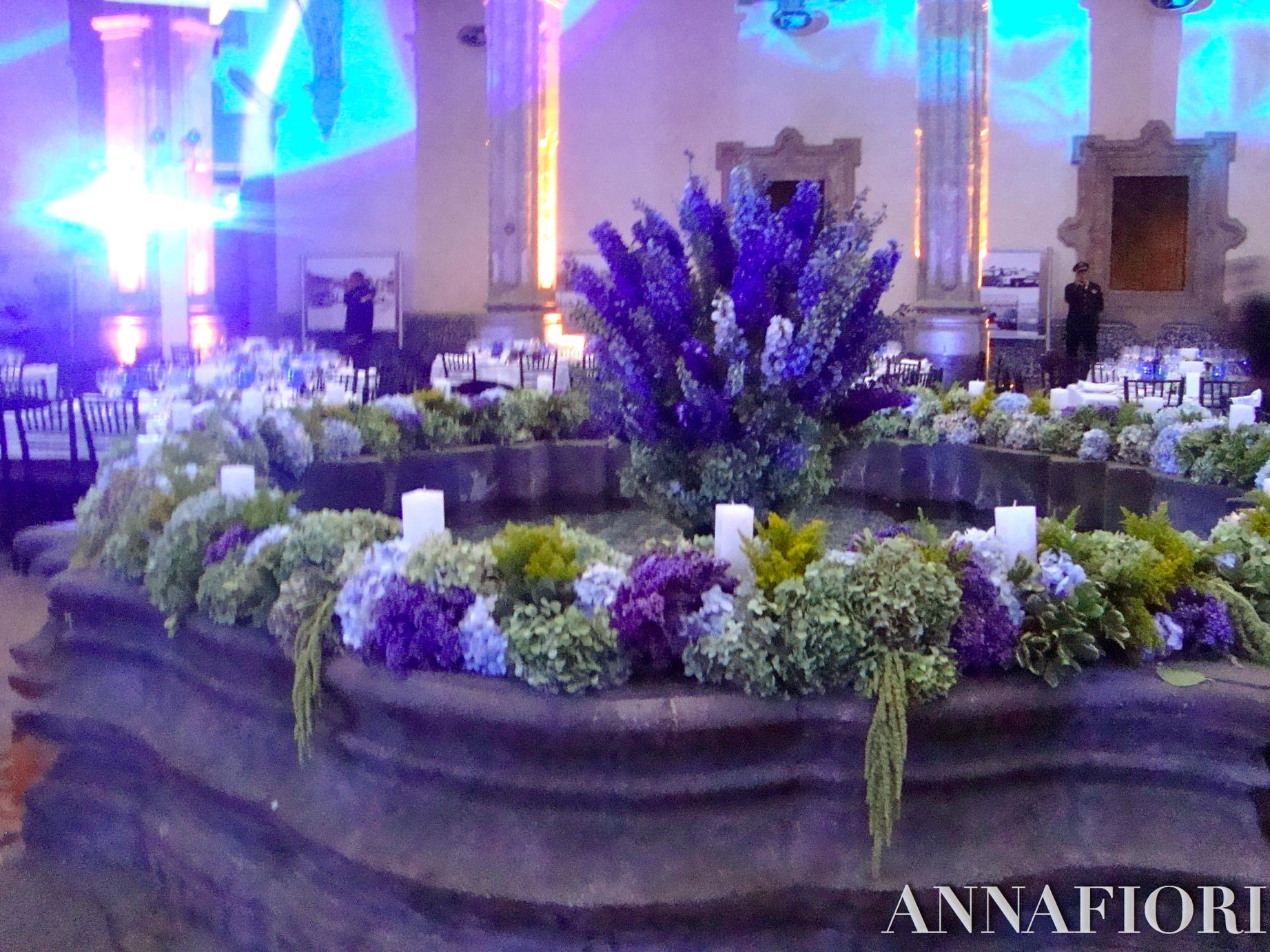decoracin de fuente con velas y flores